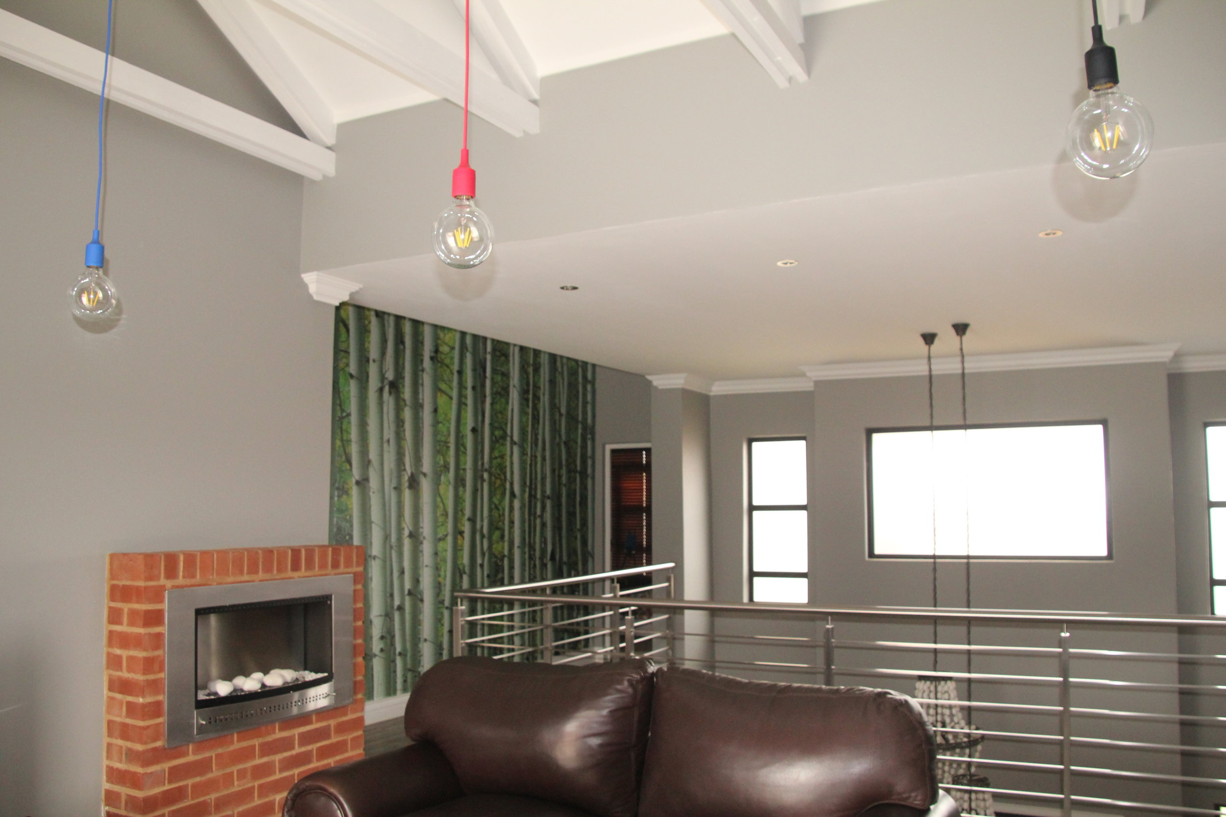 5 Pajama Lounge with fireplace and forest wallpaper.JPG