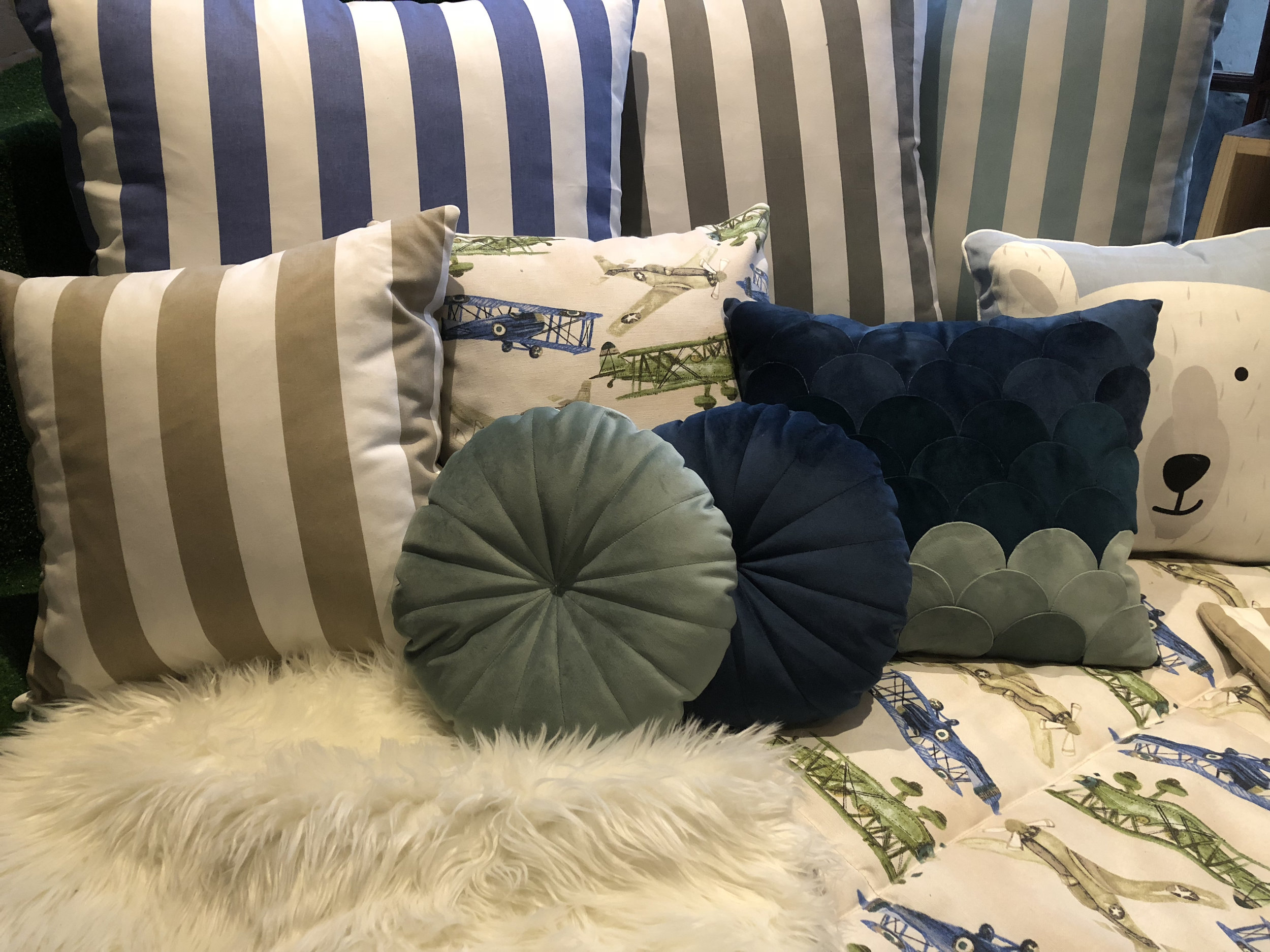 Handmade boys' playroom soft furnishings in blues and greens by Tassels & Tigers Interiors