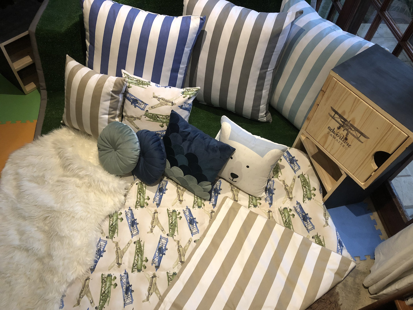 Adventure Decor In A Box Areap View of Blue and turquoise soft furnishings, turf and wood handcrafted products by Tassels & Tigers Interiors and online decor store in Johannesburb.jpg