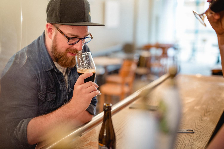 Craft beer drinker sniffing drink in North Bar Leeds