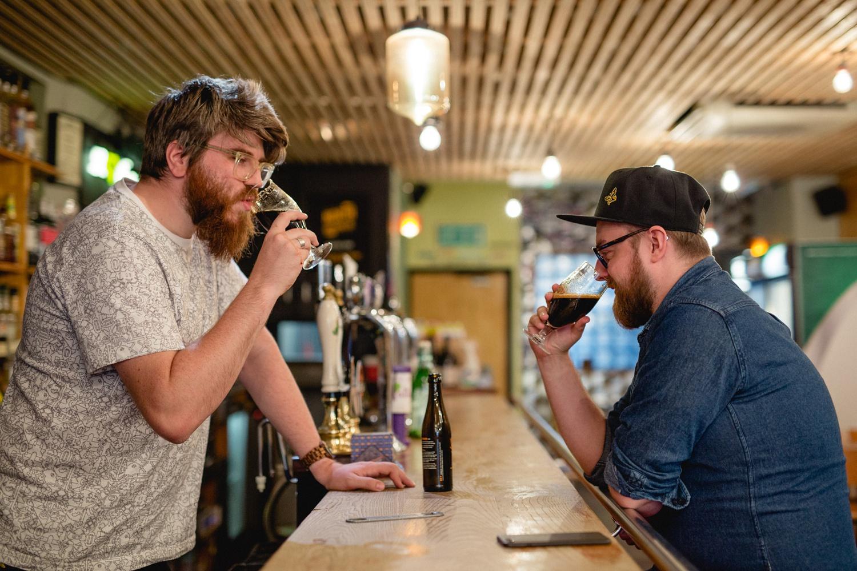 editorial photograph of drinkers enjoying a beer at North Bar