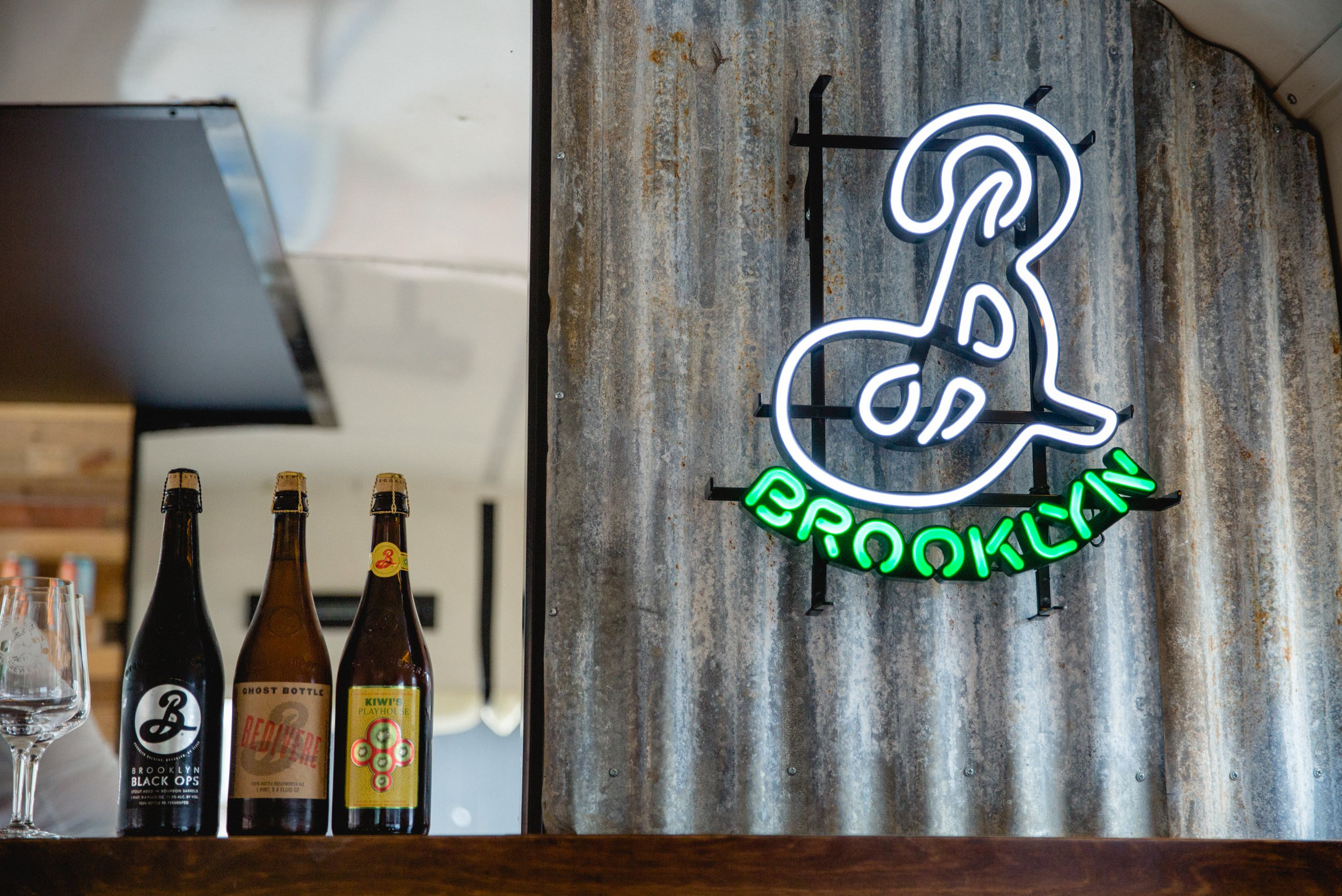 Brooklyn Brewery small batch craft beer bottles and neon logo