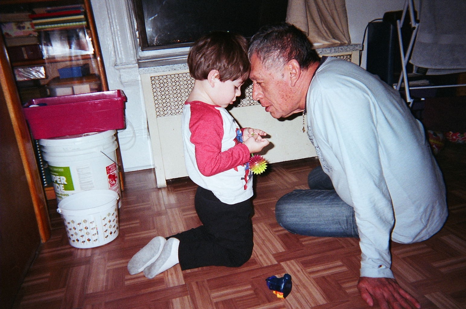 Miguel 26 - playing w: grandson.JPG