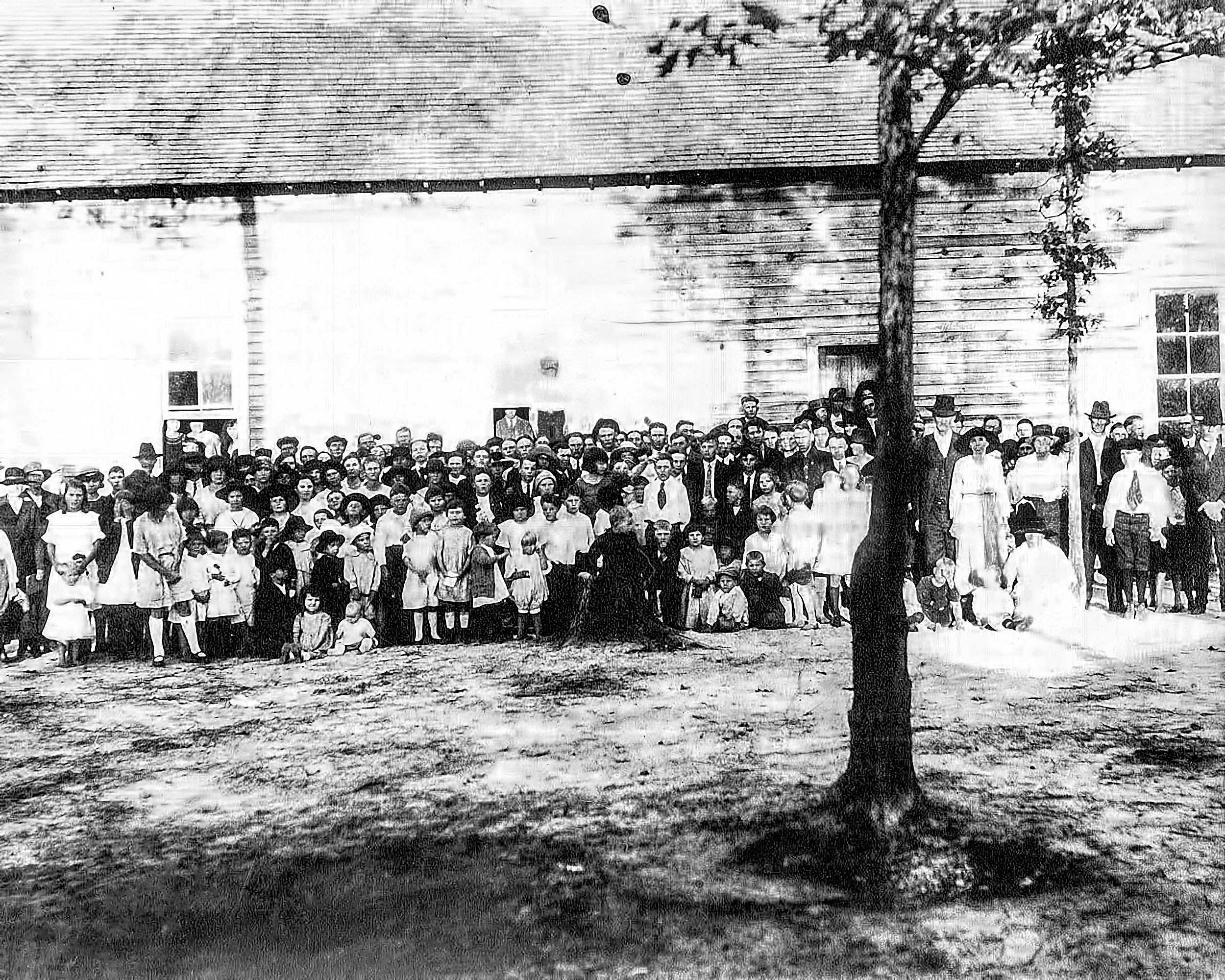 This image was labeled 1st Church picture (circa unknown). Do any old timers know anyone in the picture? or the year of this picture? Is this the 1st church building?