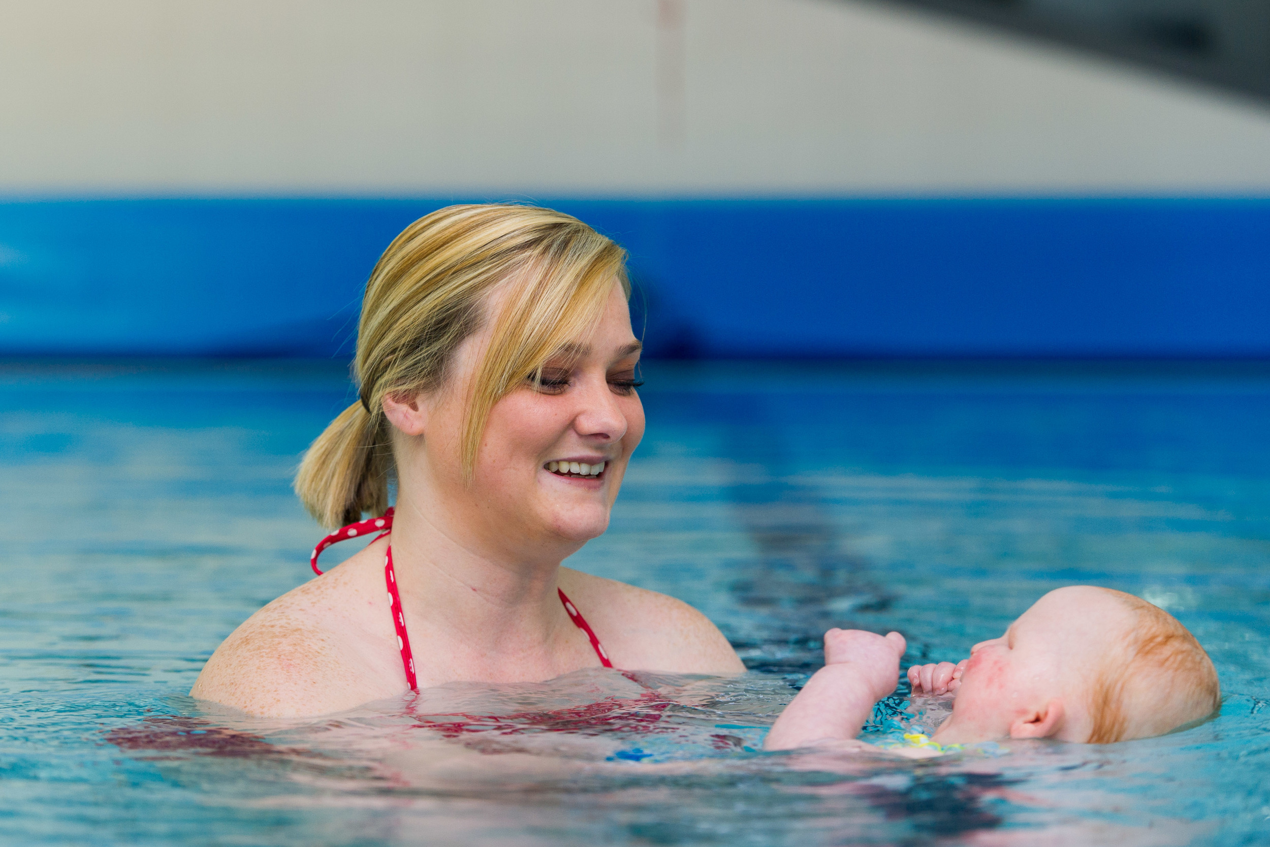 Danielle Davis and Daisy Smith swimming in Serennu Children's Centre, Newport. Daisy has anophthalmia, a rare condition that means she was born without eyes. She enjoys swimming and goes every week.