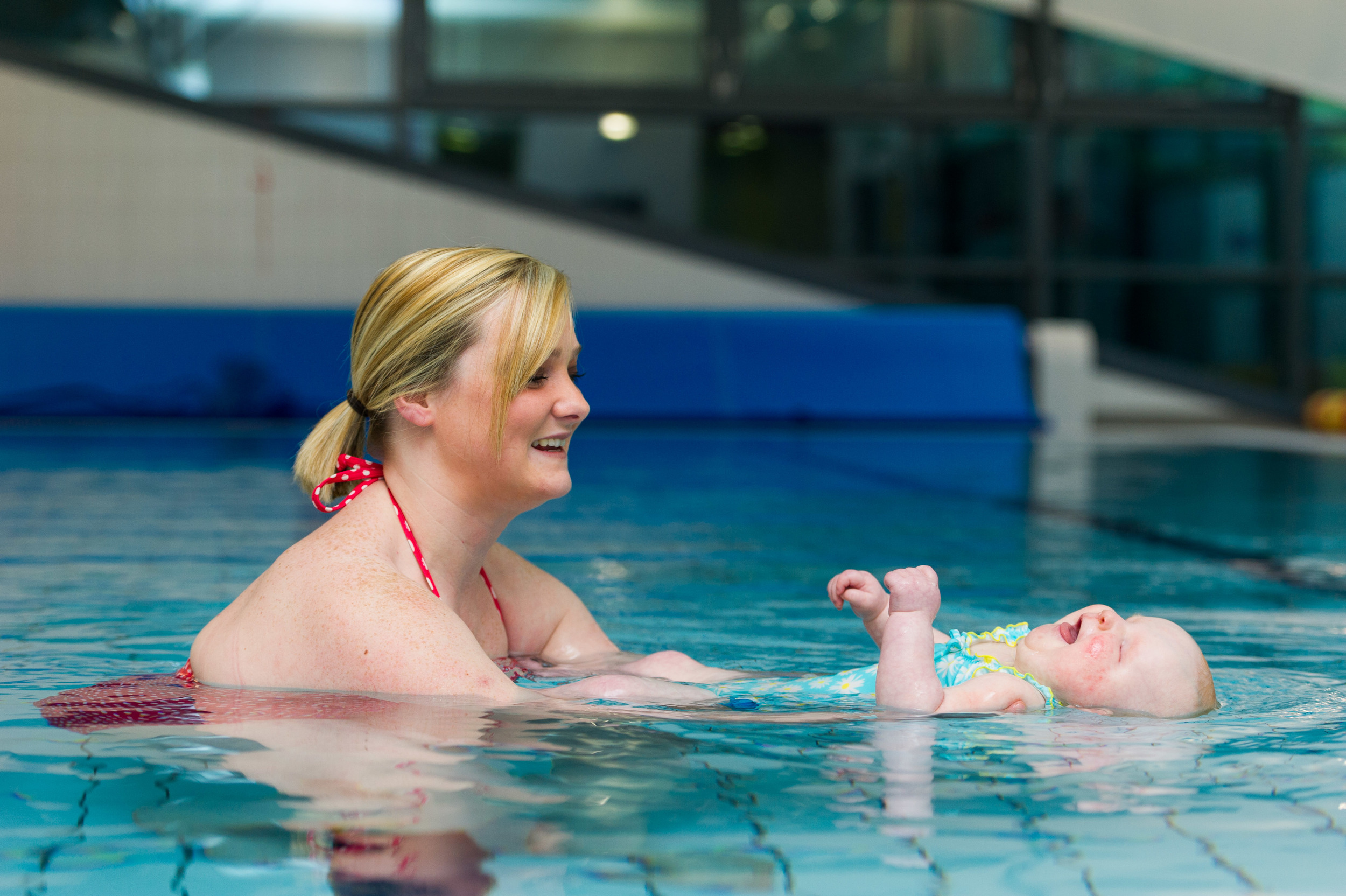 Danielle Davis and Daisy Smith swimming in Serennu Children's Centre, Newport. Daisy has anophthalmia, a rare condition that means she was born without eyes.