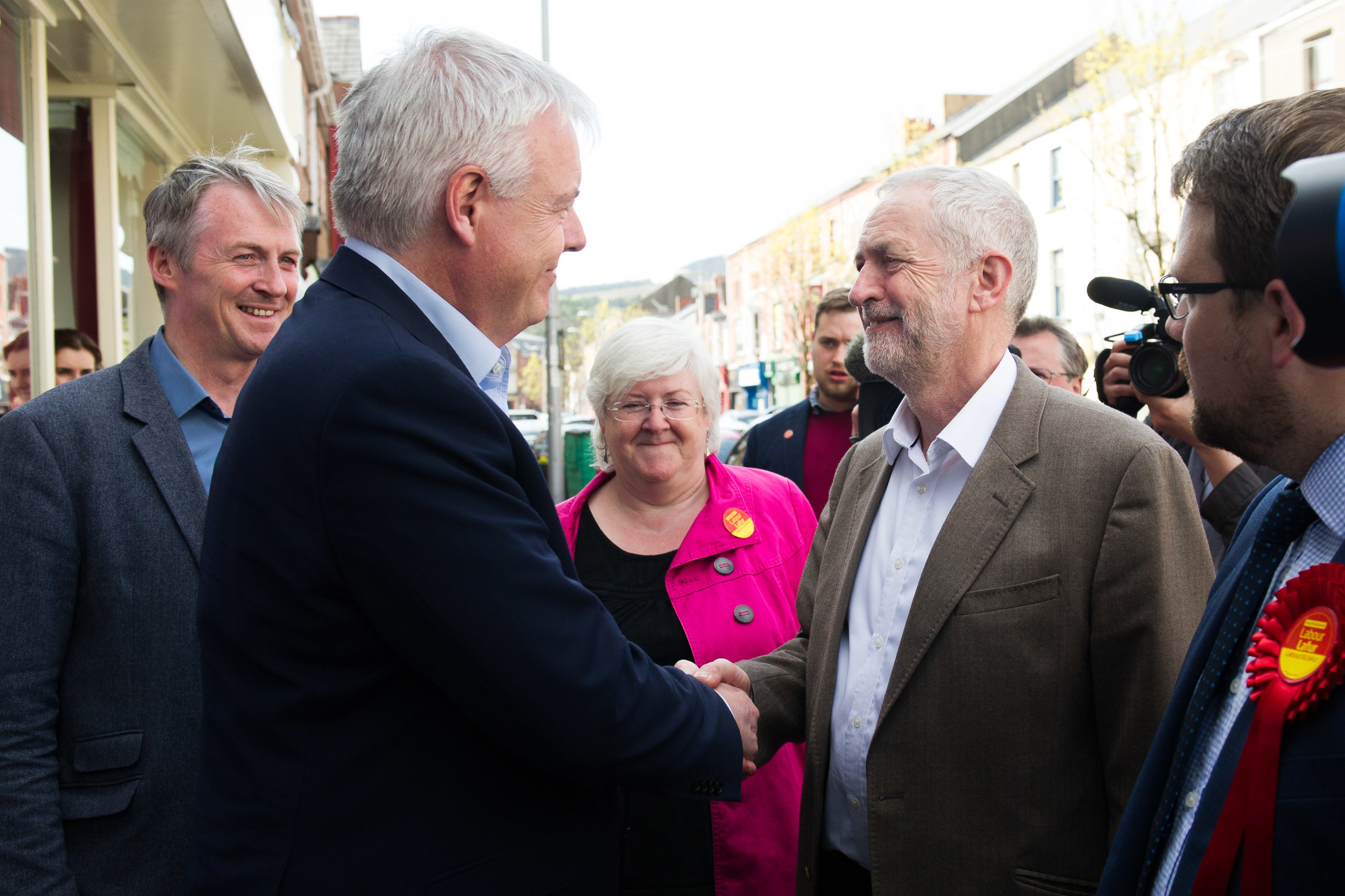 First Minister of Wales Carwyn Jones (L) shakes Labour leader Jeremy Corbyn's (R) hand