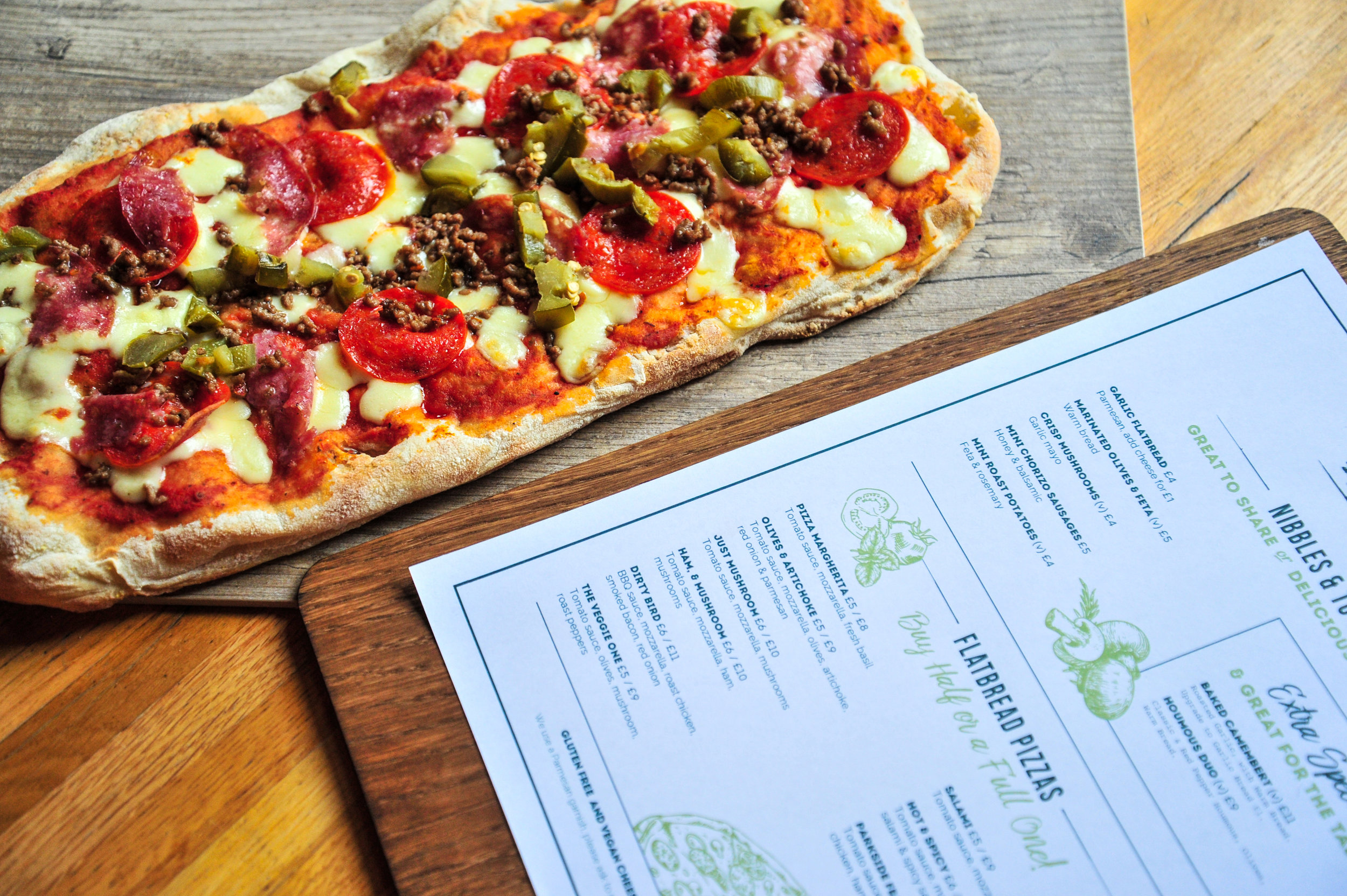 Food Menu - Introducing flatbread pizzas, sharers and nibblesTake a look at our menu below