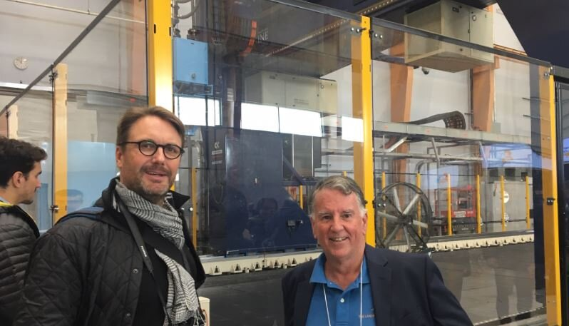 Aaron Porter (left) and Richard Downs-Honey (right) at the unveiling of the world's largest 3D Printer in Orono.