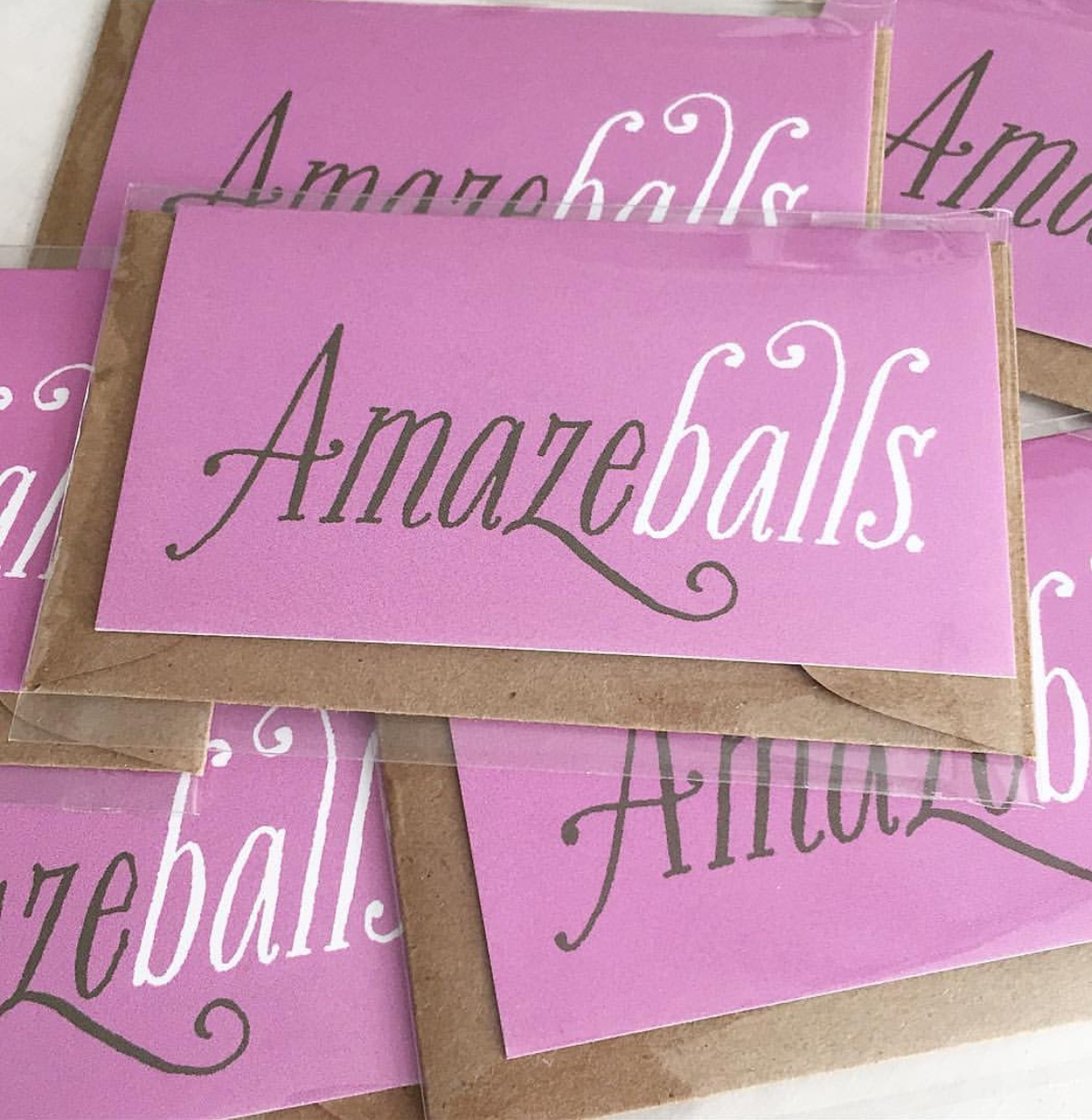 """Our """"Amazeballs"""" card is one of the most colorful, expressive additions to our Mini Breath line. The design is simple and striking, and who doesn't giggle at the word """"Amazeballs""""?"""