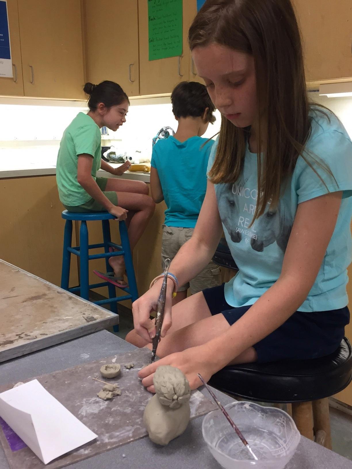 Ceramics_Student cutting clay.jpg