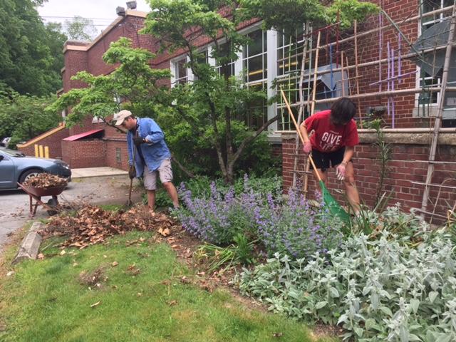 Volunteers raking.JPG
