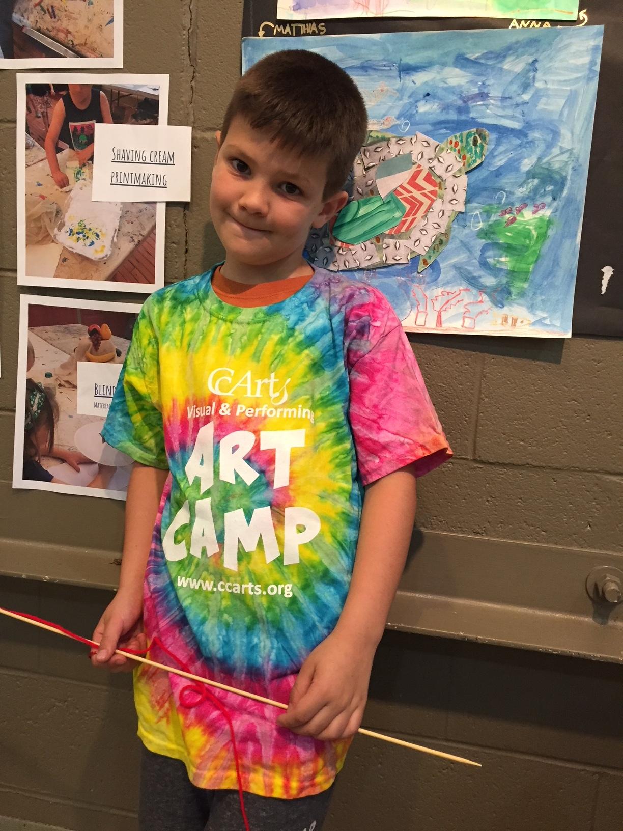 Boy in camp shirt at finale.JPG
