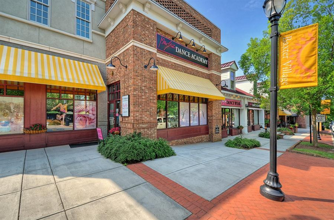 Local shops along a wide, pedestrian-friendly sidewalk.What do you think?