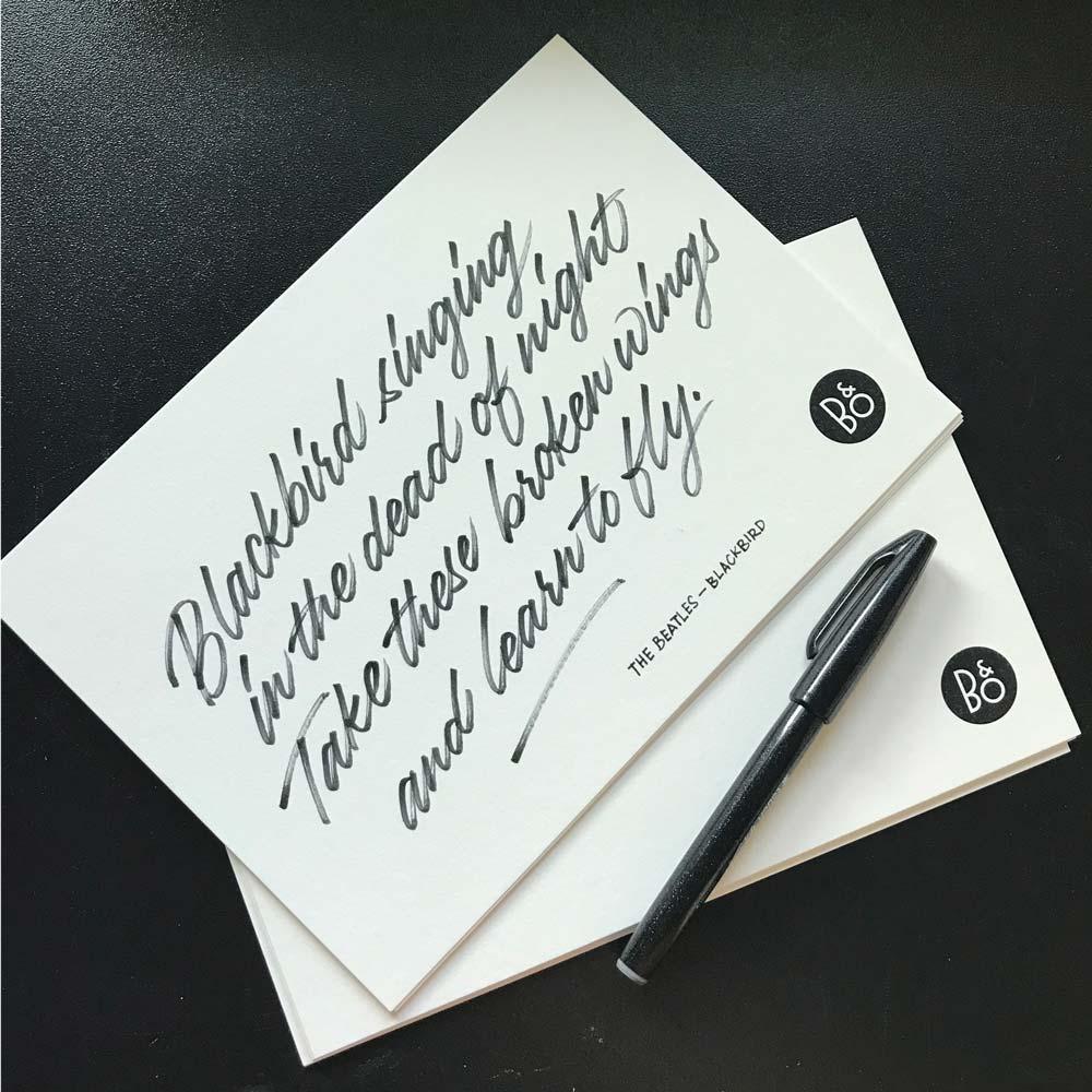 Hand written lyrics on card stock