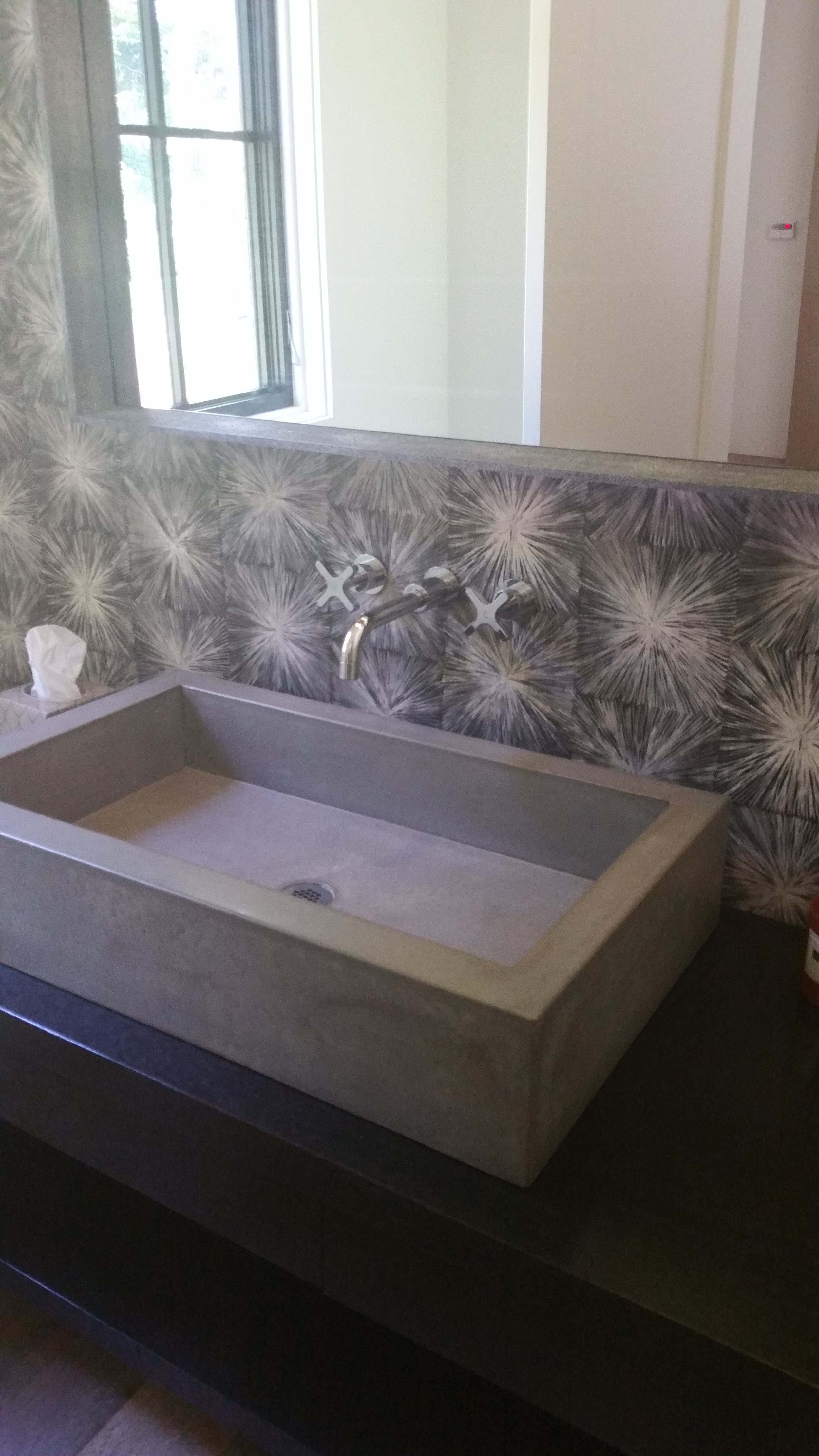 Concrete vessel sink and modern wallpaper give PR a wow factor