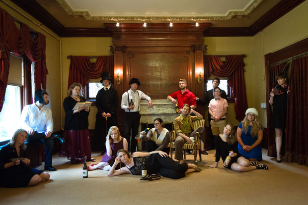 """The cast of """"The Brothers Karamazov (Unabridged)"""" pose inside the refurbished Mustard house, 920 D St. The group will perform the comedic adaptation in the house's backyard."""