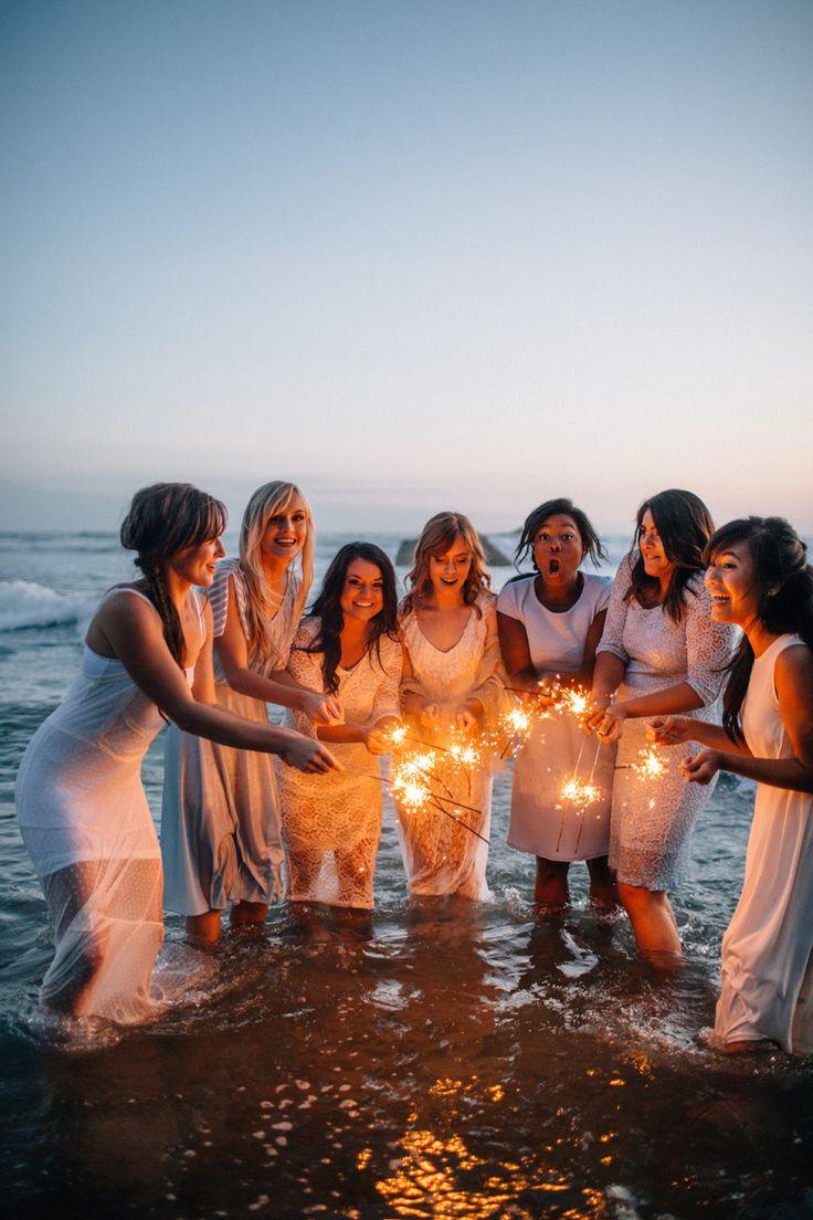 Beach sparklers bridesmaids wedding