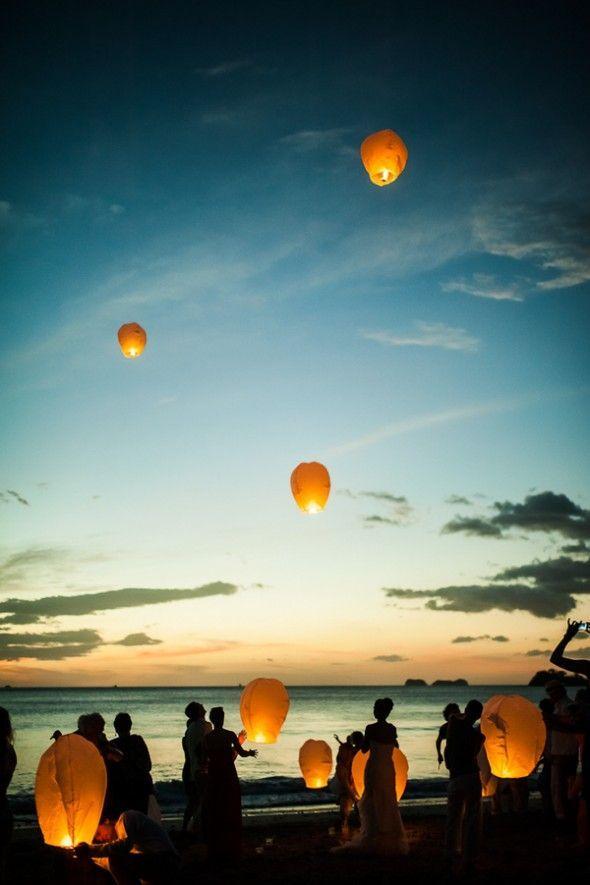 Boho beach wedding lantern release sunset