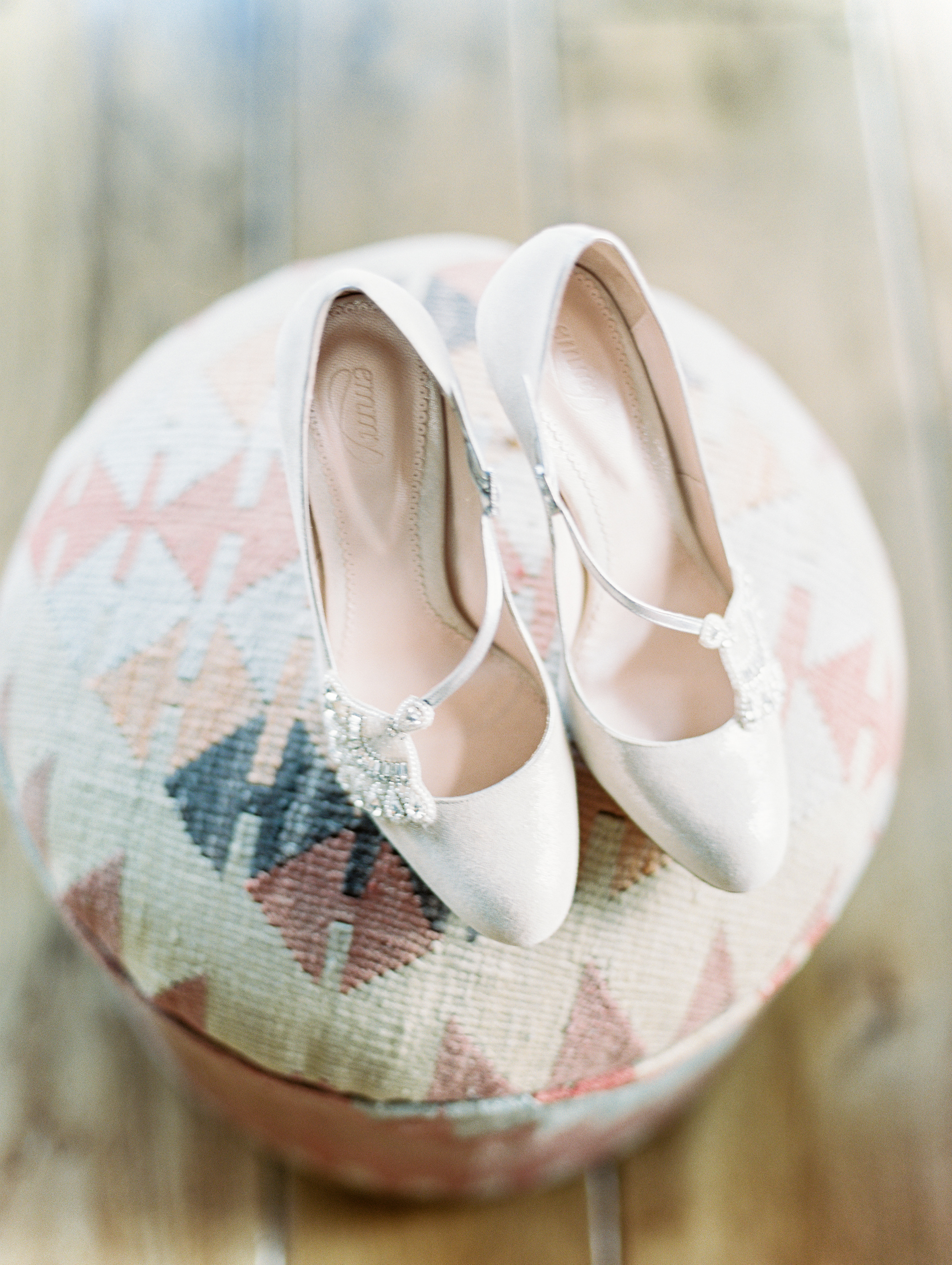 Bohemian Wedding Inspiration at Brush Creek Ranch | Emmy London shoes from Little White Dress Bridal Shop | Photography: Lisa O'Dwyer
