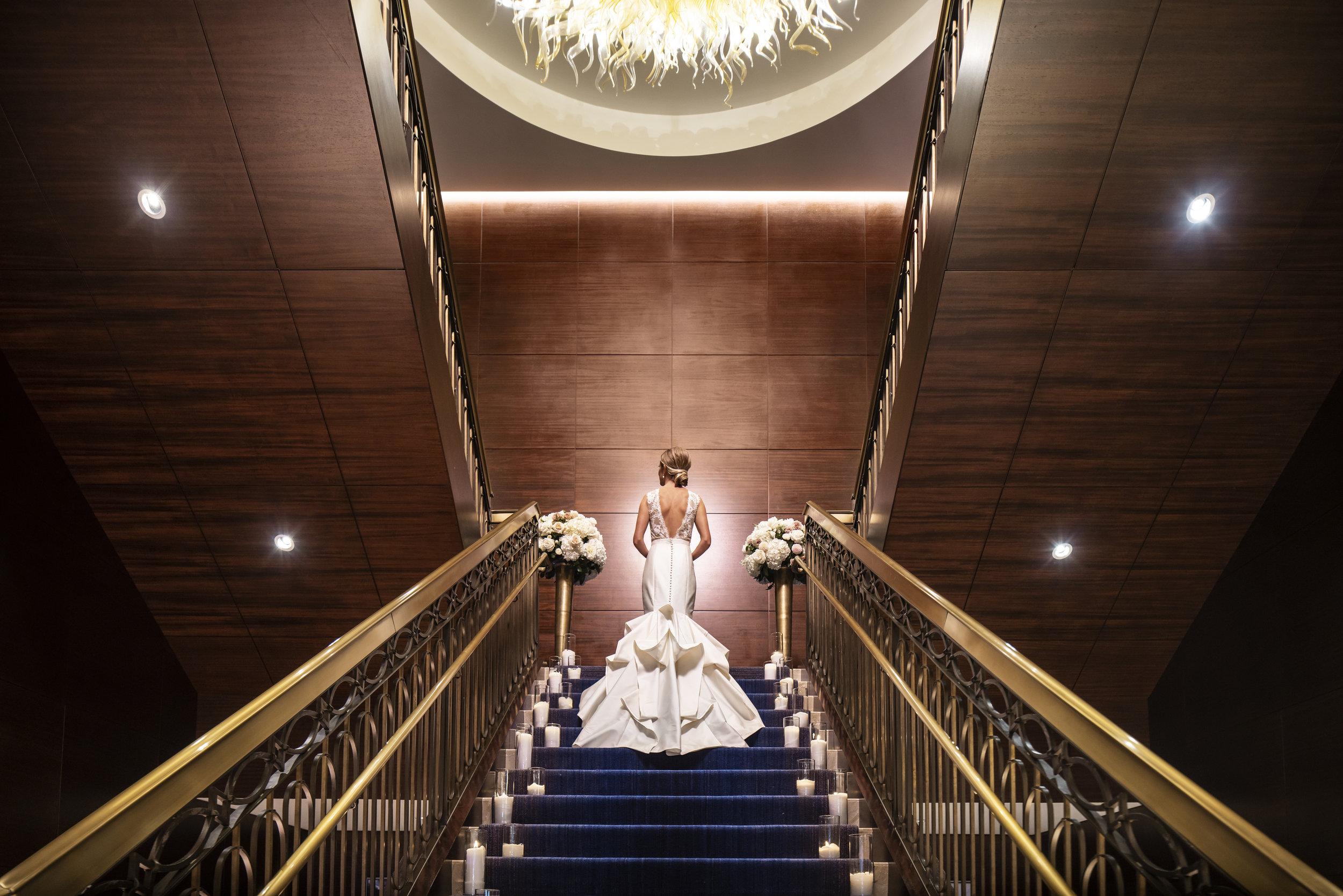 The Ritz-Carlton, Denver Weddings - Bride & Grand Staircase Primary.jpg
