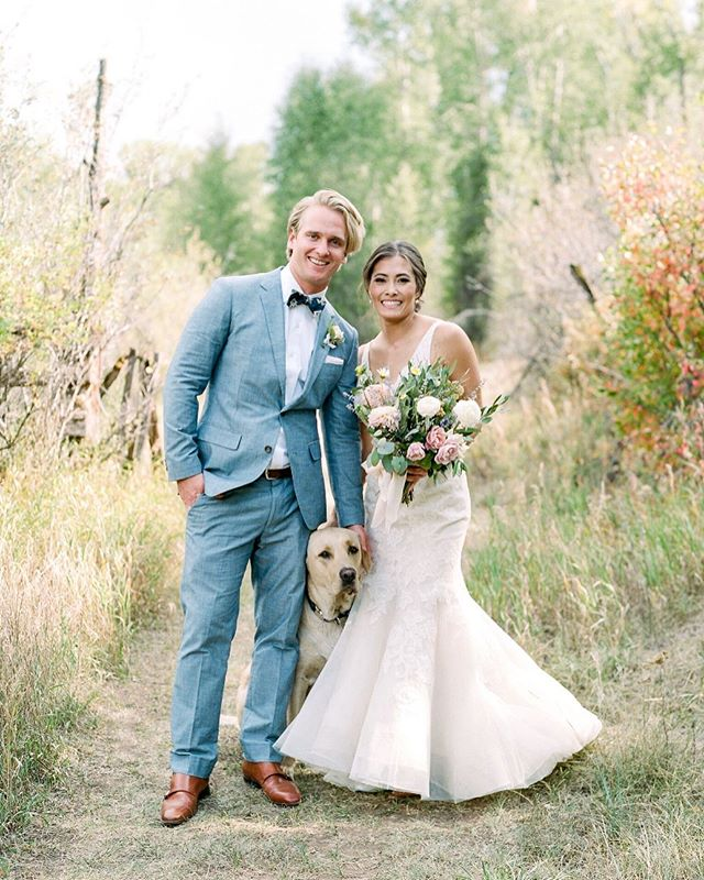 So we decided to make #WeddingDogWednesday a thing. 🐾💍🐶 Check out our stories to see a few of our brides and their sweet pups! Pictured here: #LWDbride Margaux and her husband and doggo, who likes playing peekaboo with his mom and dad but is a little confused about why they are dressed up so fancy. • photo by @rachelhavel