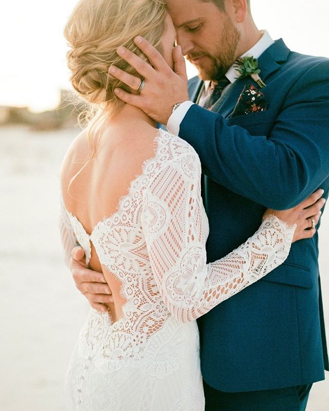 Ashley + Keith, married on St. George Island. Ashley chose the Shenandoah gown by @clairepettibone and looks so beautiful, happy, and at ease on a magical beach day. • photos by @shannongriffin • florals @missygunnels