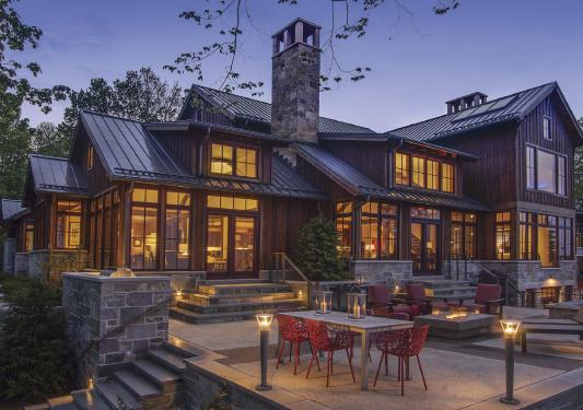 Outdoor living is at its best from the raised terrace that includes an outdoor kitchen, dining area, fire table and hot tube -- and magnificent lake views.