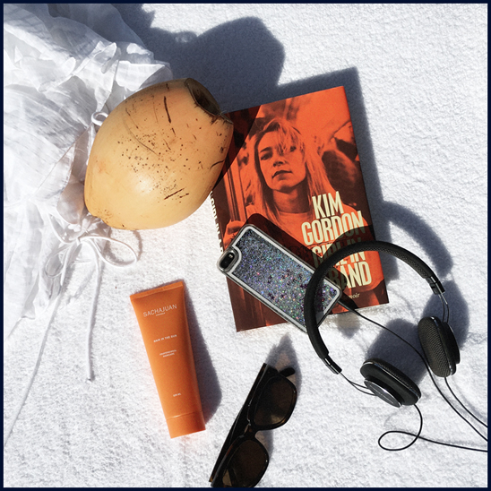 Pool side essentials:  Loup Charmant  cover-up, Sachajuan  Hair In The Sun,  Céline sunglasses,  Girl in a Band: A Memoir  by Kim Gordon,  Bowers & Wilkins  headphones