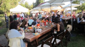 festival style food station dining on those fabulous farm tables-totally fun