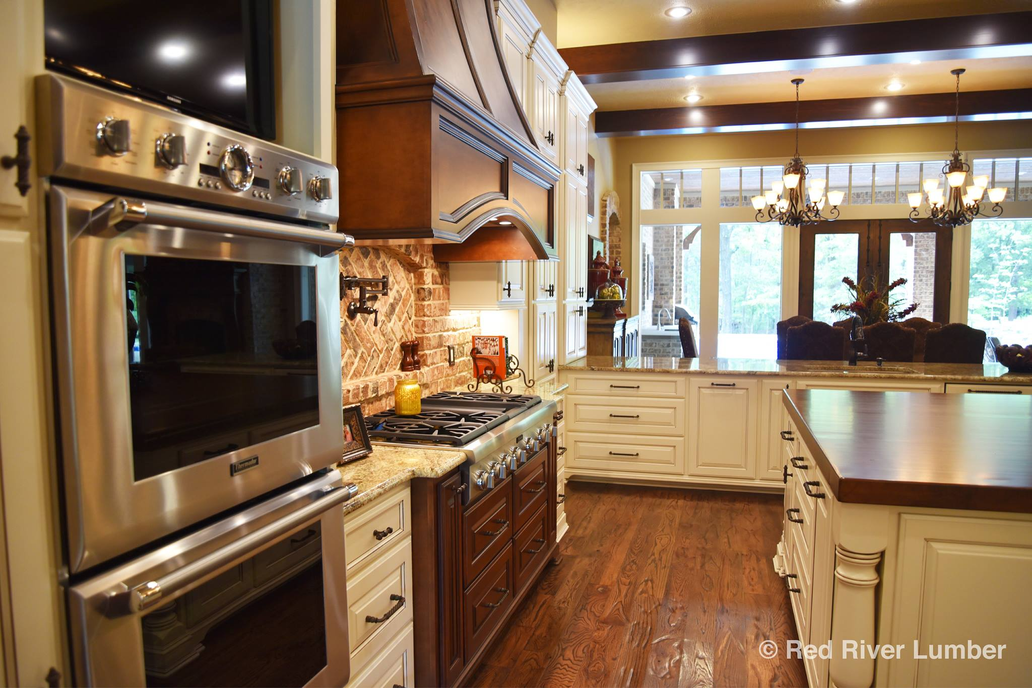 We supplied the  Thermador 30-inch Double Oven, Thermador 48-Inch Gas Rangetop, and Siena Beige Granite Countertops.