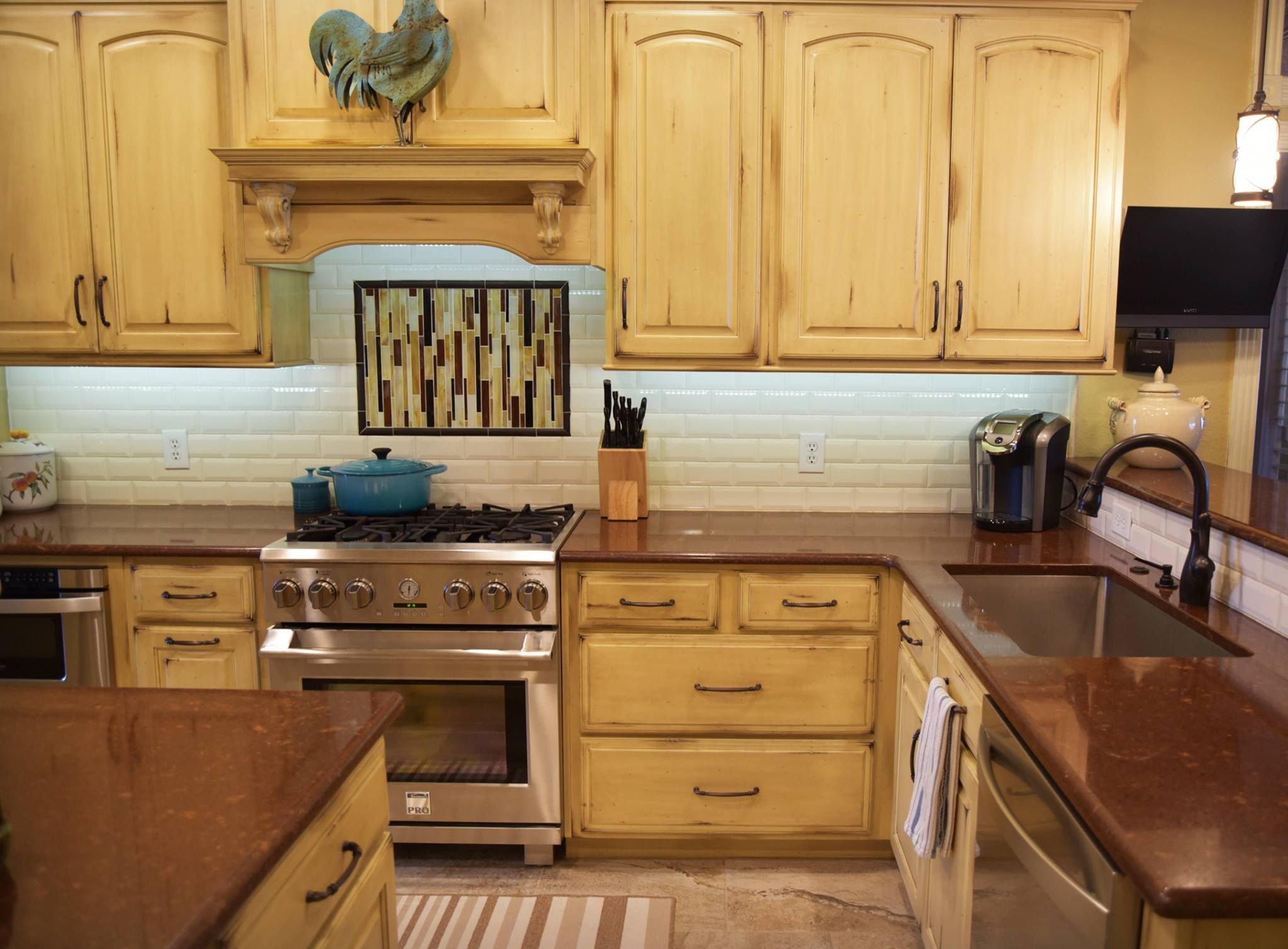 We provided the cabinets and countertops for this beautiful kitchen remodel! Shiloh Cabinetry: Olde World Finish - Cornsilk Countertops: Cambria Quartz - Burnbury™