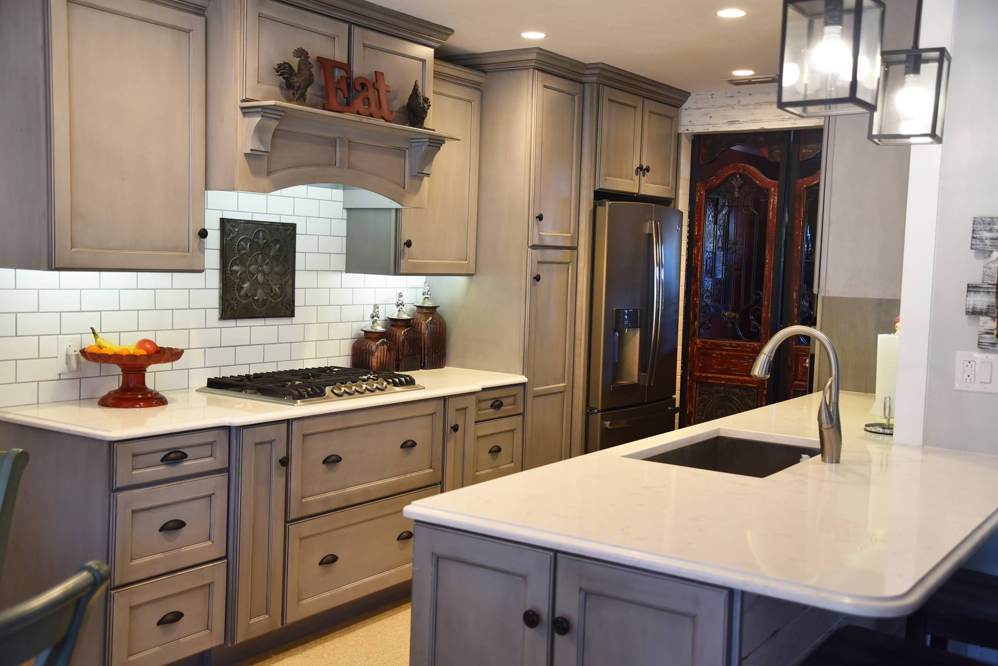 We supplied MidContinent Cabinetry: Ash with Black Glaze, Cambria Quartz Countertops: Style - Torquay, and a Soci Single Bowl Stainless Sink.