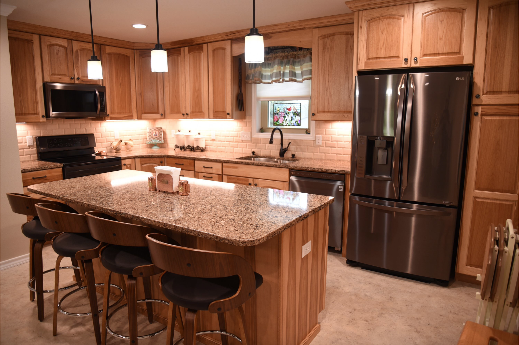 MidContinent Cabinetry ,  Cambria Quartz countertops , 3x6 Mexican Travertine tile,and a  Soci sink  are included in this kitchen project.