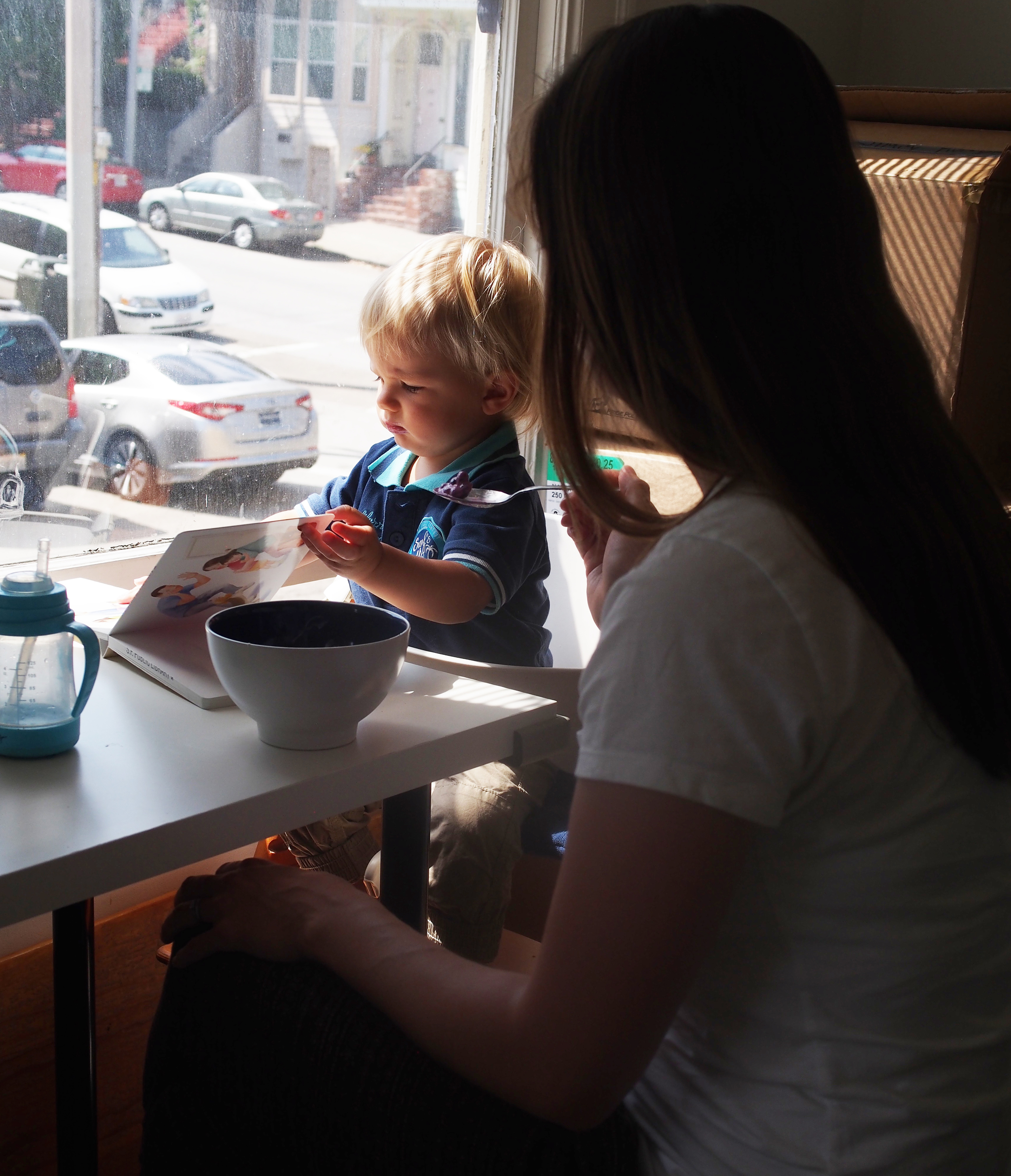 Snack time for Hunter. A second hand Stokke high chair and small table at the wall allow for a dedicated eating space.