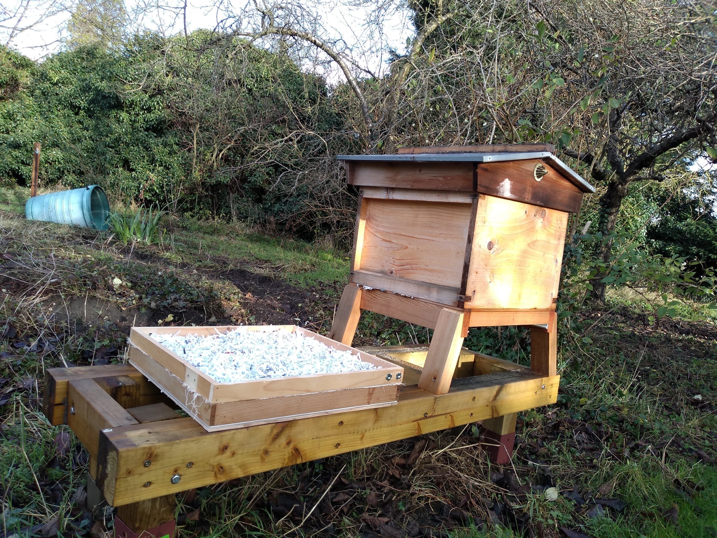 Stacked sugar board and dry board waiting to be added to Queen Romaine's hive.