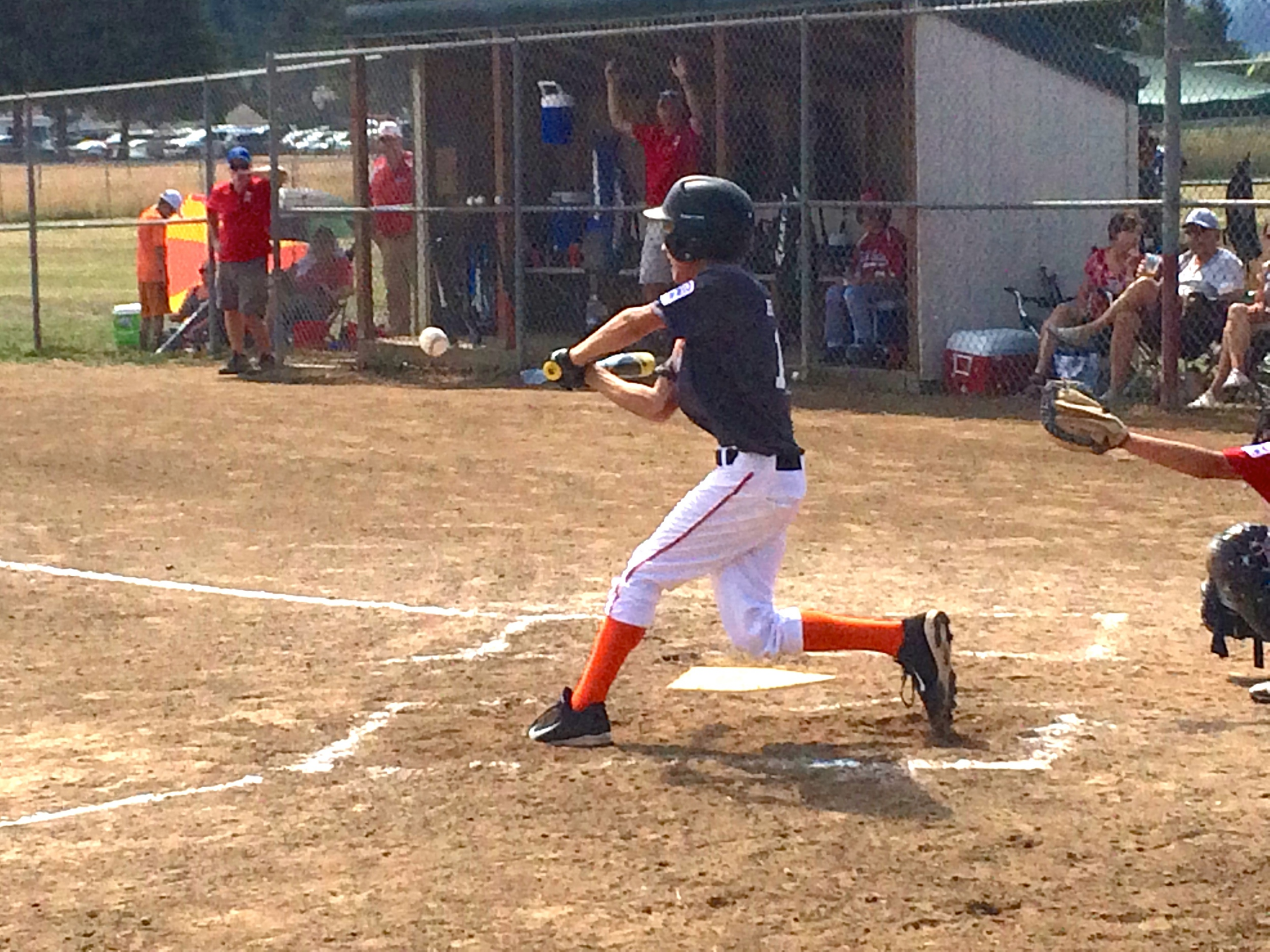 Eli at Bat - This is one of my best action shots. Elihammered it past the centerfielder.