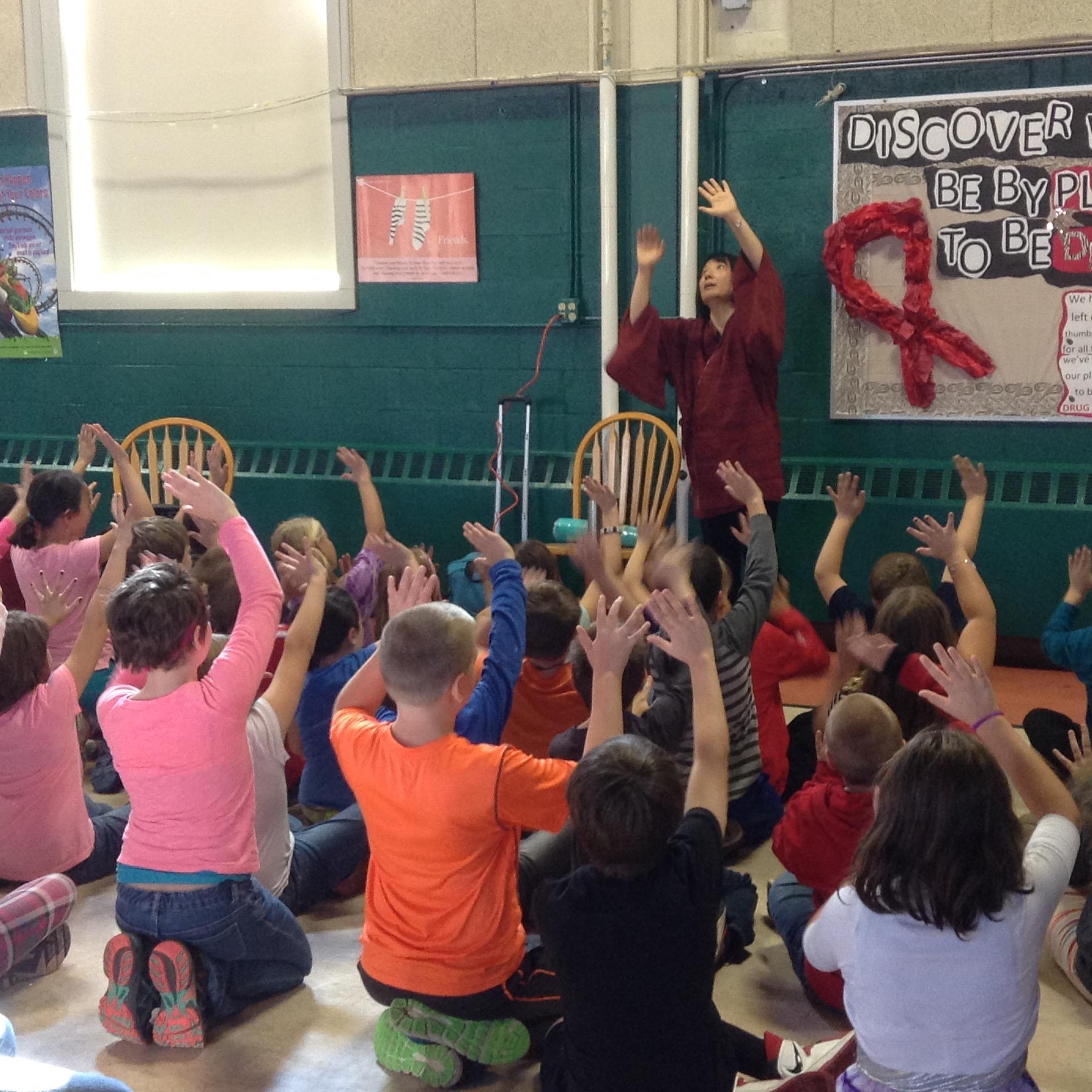 Students practice miming with Motoko.