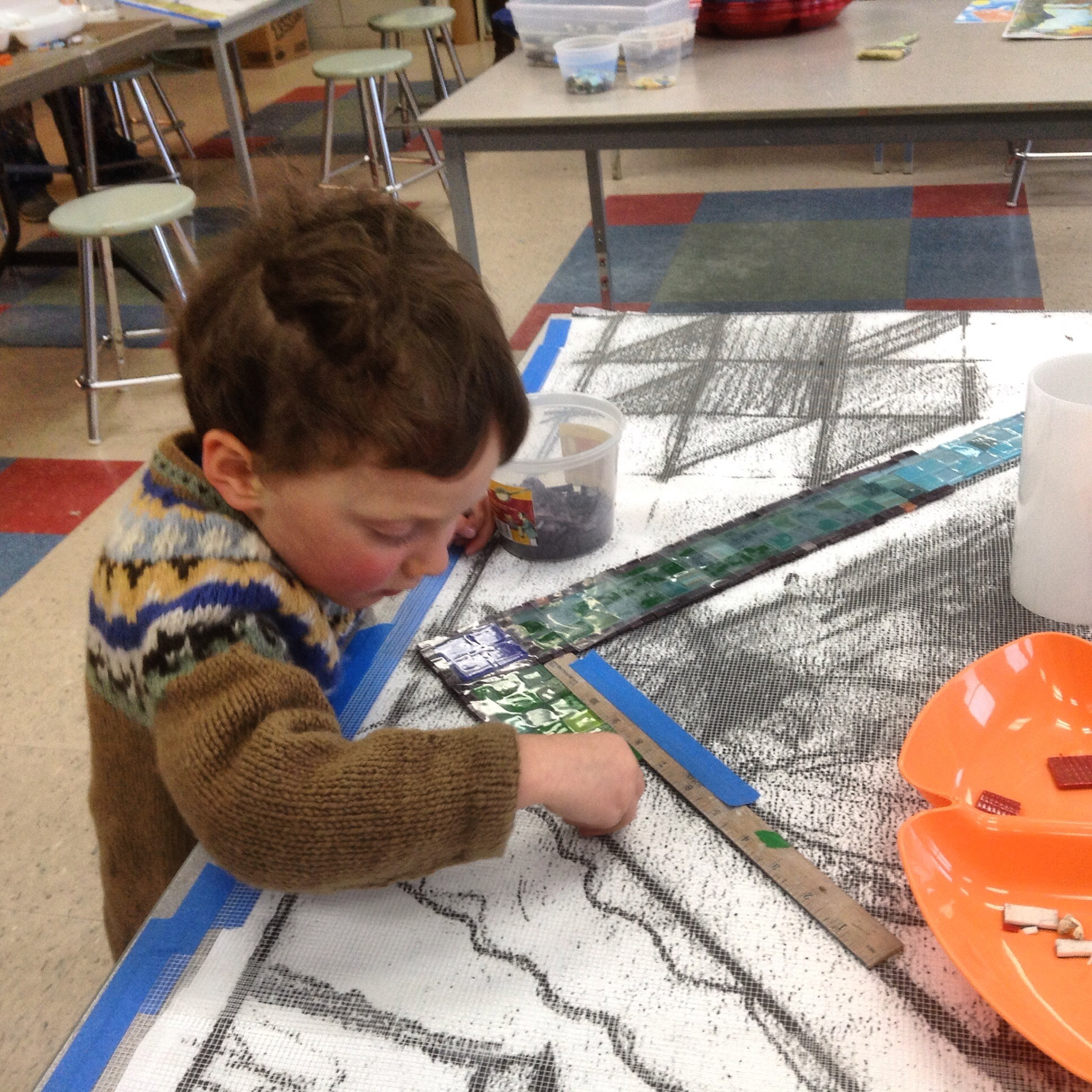 At three years old, one of our youngest mosaic artists...