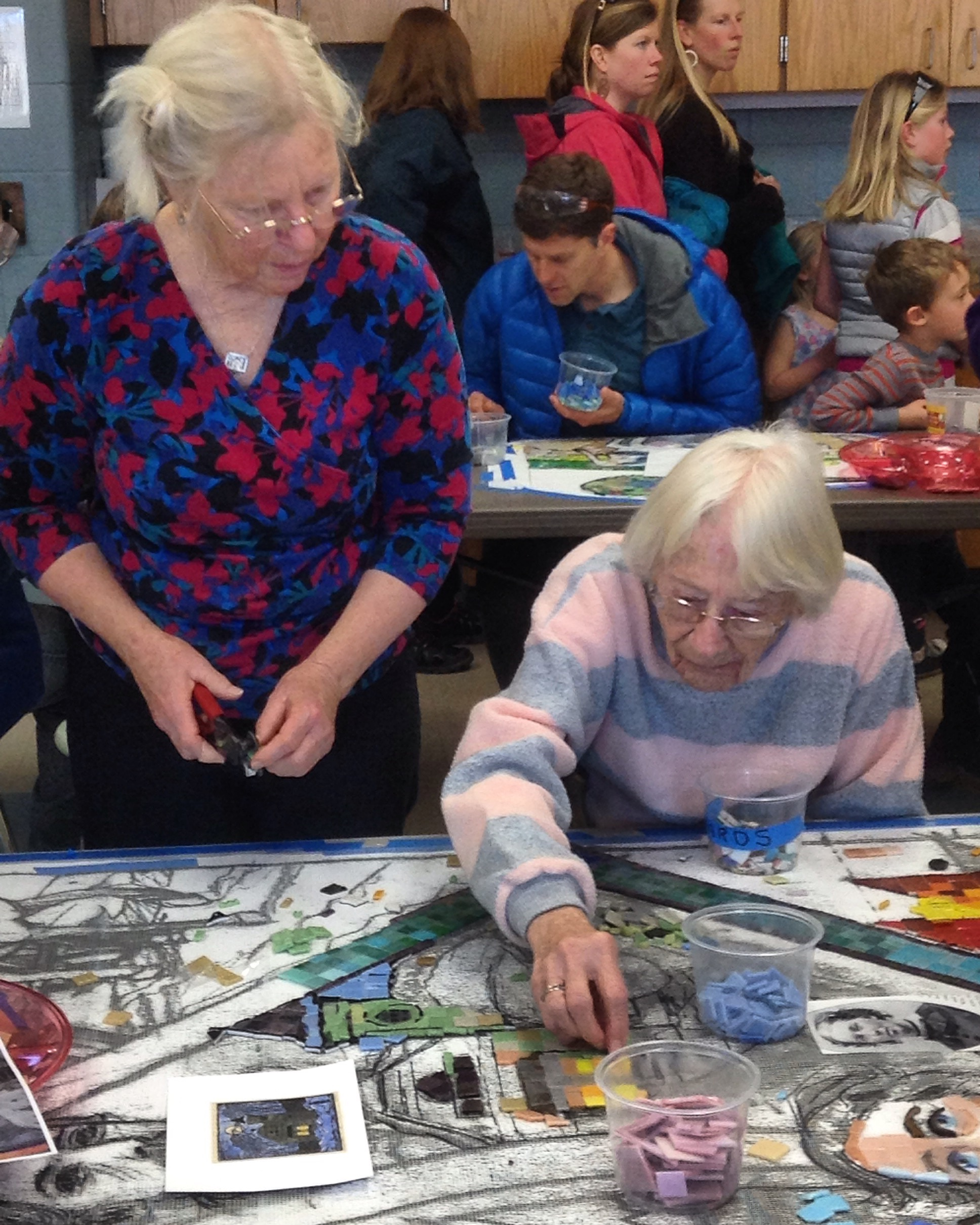 Two of Tamworth's former head librarians build the depiction of the Cook Library.