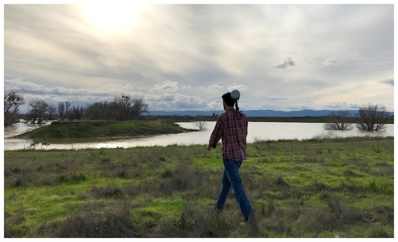 Paul Frank surveying an inundated floodplain site on Cache Creek