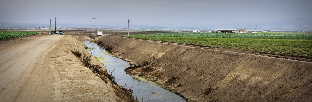 The Blanco Drain is miles long, cuts through the lower Salinas Valley, and drains runoff and irrigation excess to the Salinas River and ultimately Monterey Bay.