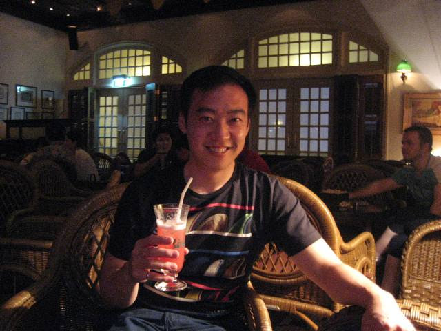 Celebrating a day in the sea like a proper tourist should: in the Long Bar of The Raffles Hotel, home of the Singapore Sling.
