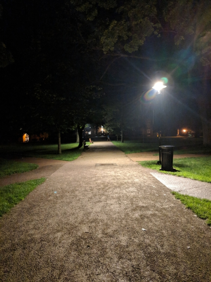 The famous Middle Path, which connects the original Kenyon College buildings to the rest of campus, through the town of Gambier and to the dorms. During the day, there are writers alongside the grass, sprawled in Adirondack chairs, typing on laptops across the benches. During the night, you're alone with your thoughts (and your writing prompts that you haven't finished yet).