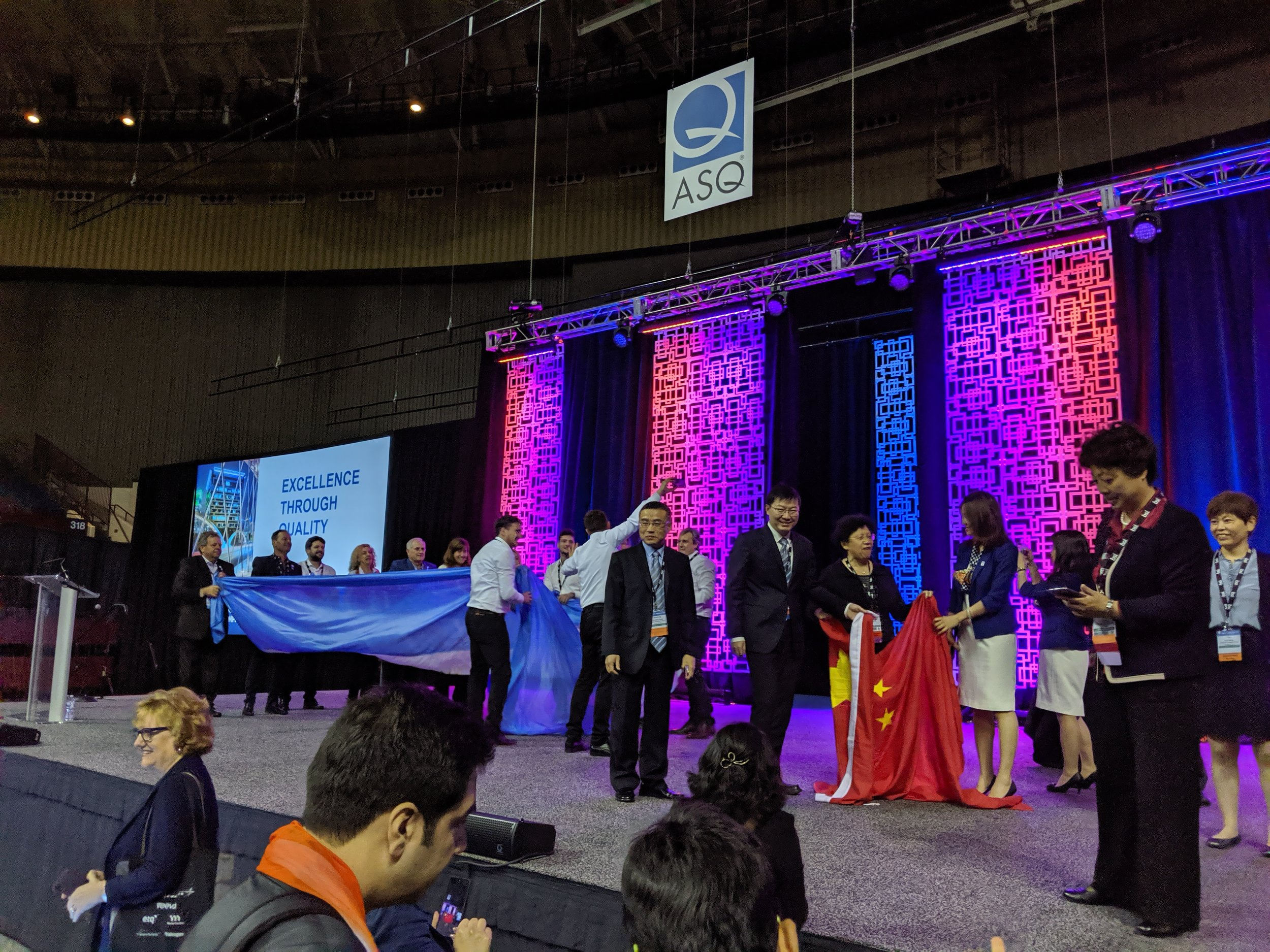 All the finalists and Bronze / Silver / Gold recipients were so enthusiastic and beaming with national pride. Here the Argentinian and Chinese teams post flag waving ceremony for their performance in continuous improvement case studies from their respective companies.
