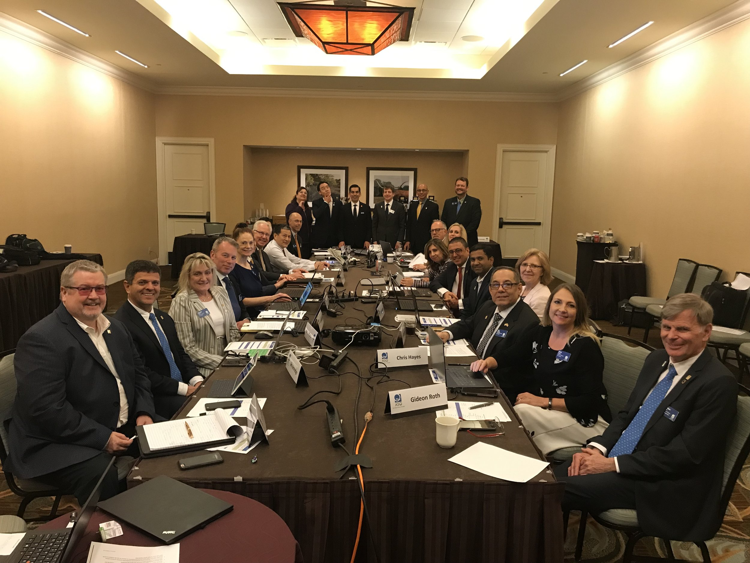 The ASQ Board settling into work mode in one of the Sundance conference rooms inside the Omni Fort Worth.
