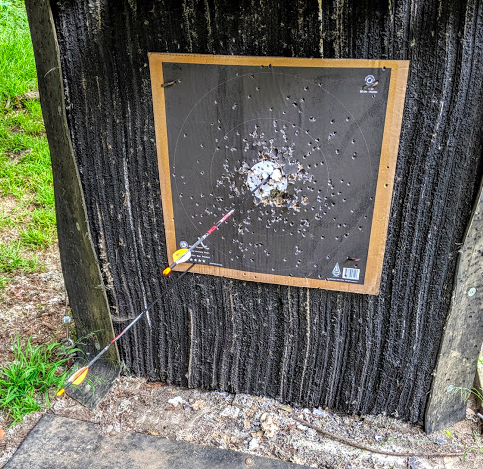 My first X-bullseye at forty yards. This is a three-arrow end, meaning I shot a round of three arrows. With one arrow nowhere to be seen and another just barely punching paper, this presents an accurate picture of my skill level. It was still pretty cool, though and I skipped all the way back to the starting line.