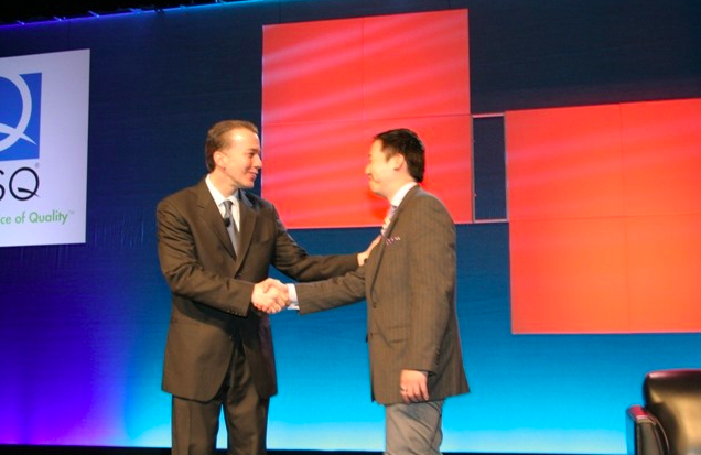 On stage with 2013 ASQ President John Timmerman for a congratulatory handshake during the medal ceremony.