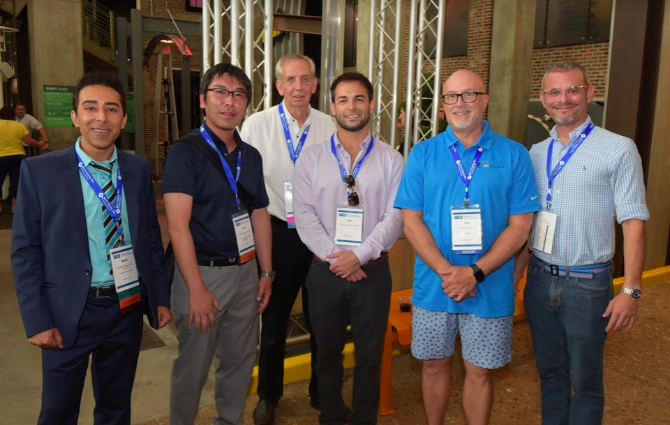 At the conference reception at Science City, an interactive family science museum in downtown Kansas City. Pictured here with the Incoming President of the Japan Society of Professional Engineers (second from left), one of NSPE's international sibling societies.