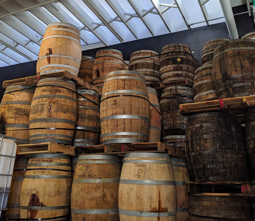 Barrels soon to be blessed by Angel's Envy for a second maturation. The darker wood barrels on the right are 40+ year old rum barrels from the Caribbean!
